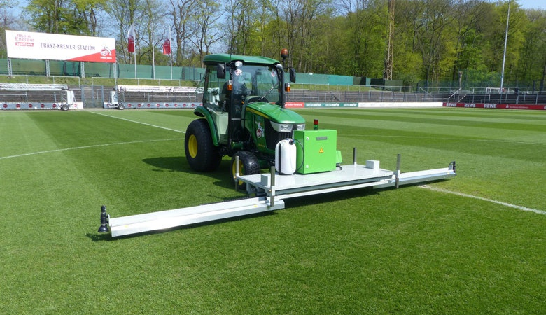 Mobile RHENAC UVC 600 lawn disinfector in use on sports surfaces